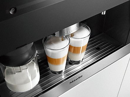 Miele black built-in coffee system making two lattes